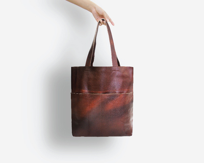 Brown pocket leather tote thumb