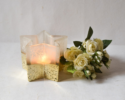 Star shaped ivory and gold candle holder thumb