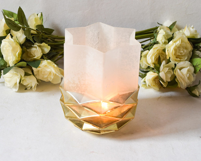 Pine cone ivory and gold candle holder thumb