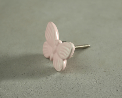 Pink fly high butterfly knob thumb