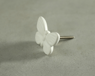 White fly high butterfly knob thumb
