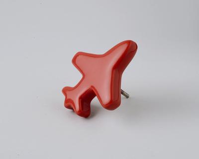 Red aeroplane knob thumb