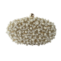 Gold oval pearl bag small