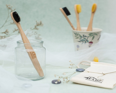 Bamboo tooth brush thumb