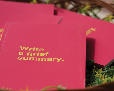 Write a grief summary notebook thumb
