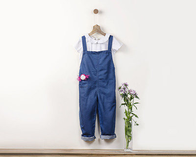 Indigo denim washed unisex romper with fabric brooch thumb